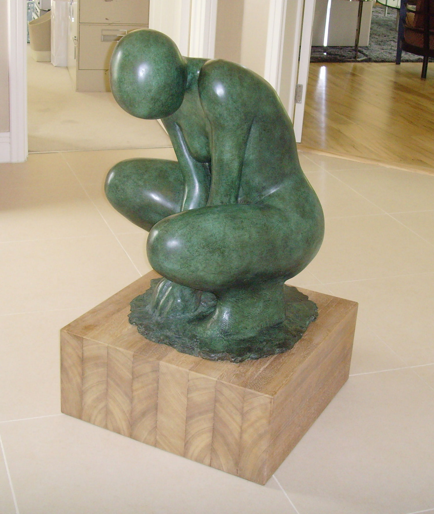 Bronze sculpture of life sized crouching female form for garden or interior.