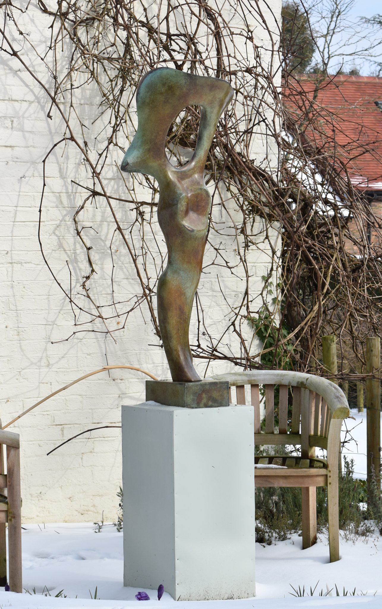 Bronze abstracted sculpture of a bone form for garden setting.