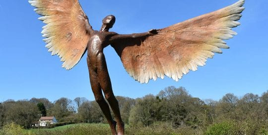 Icarus I Bronze sculpture in garden