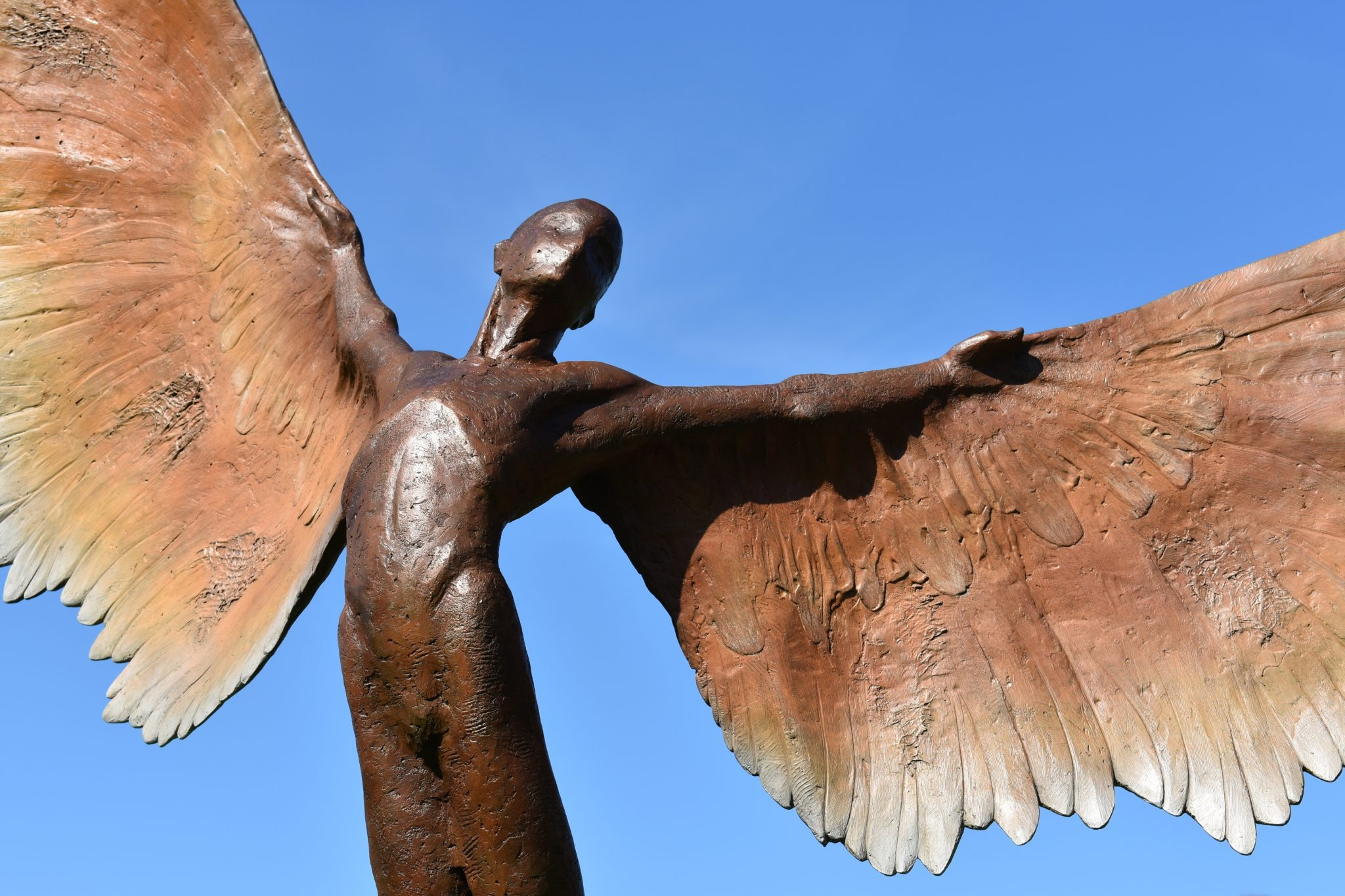 Young boy bronze with wings