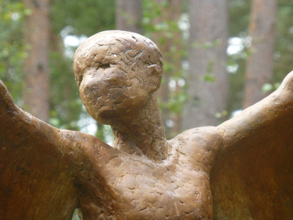 Icarus II. Large bronze mythological sculpture in garden.