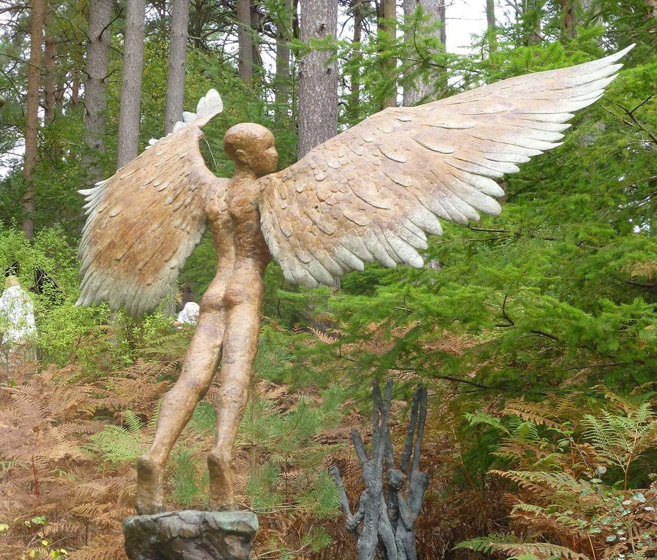 Icarus II. Large bronze sculpture in garden.