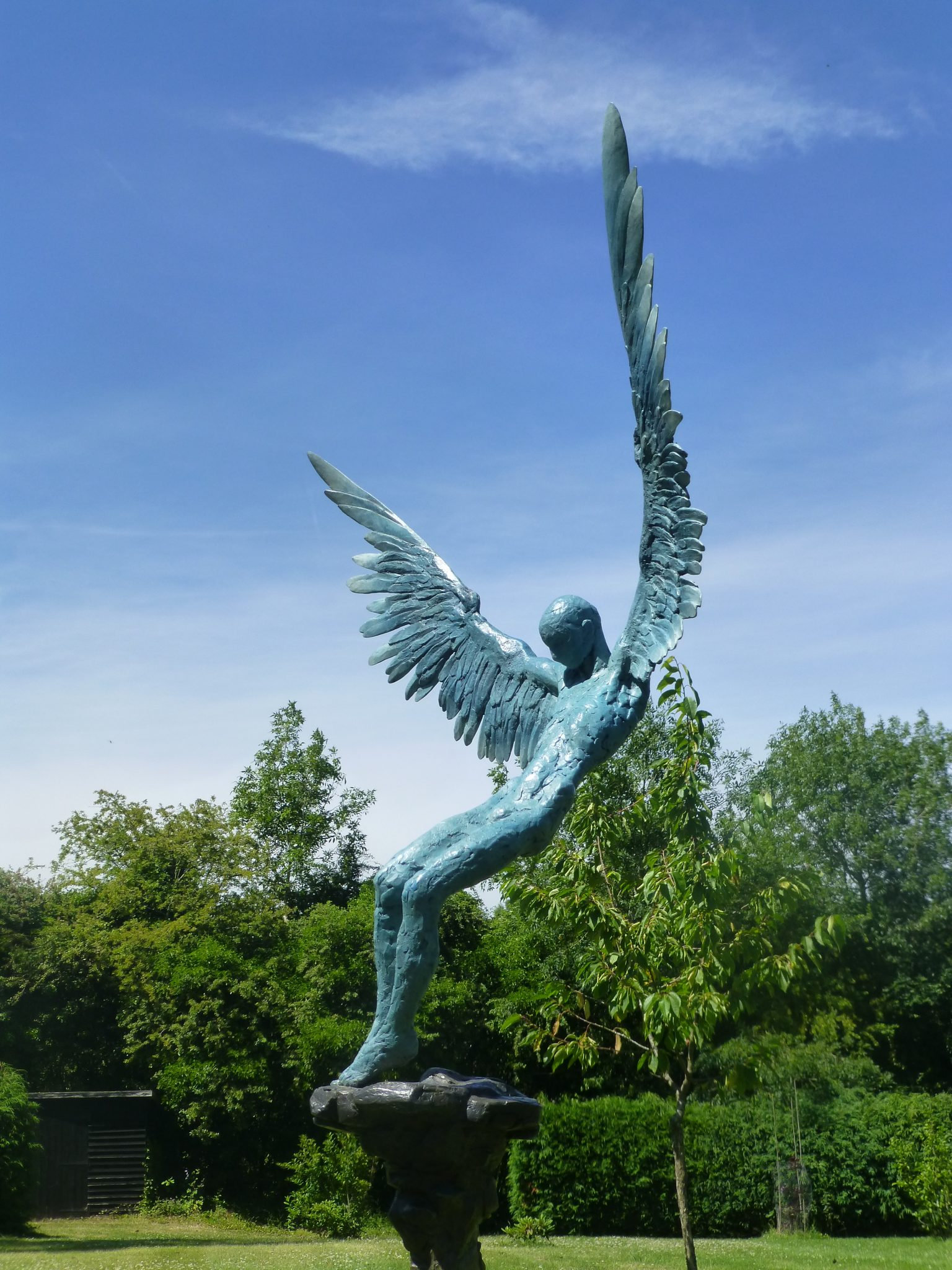 Sculpture in bronze of Icarus falling from the sky.