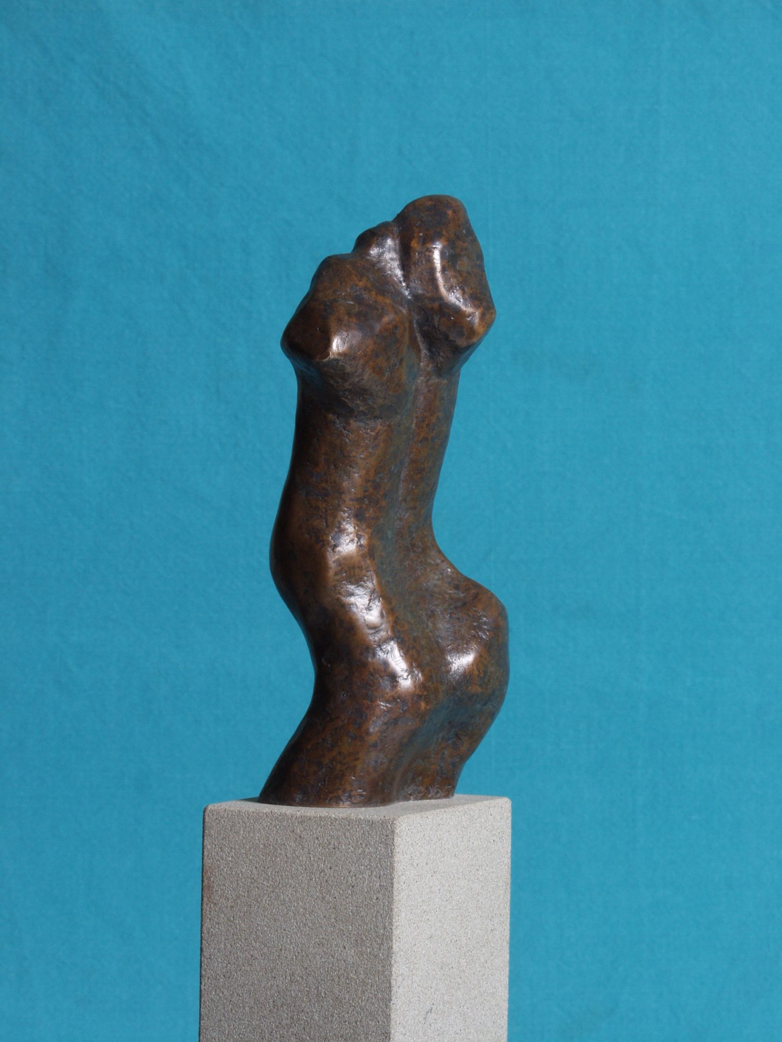 Adam I. Small bronze sculpture of male torso.