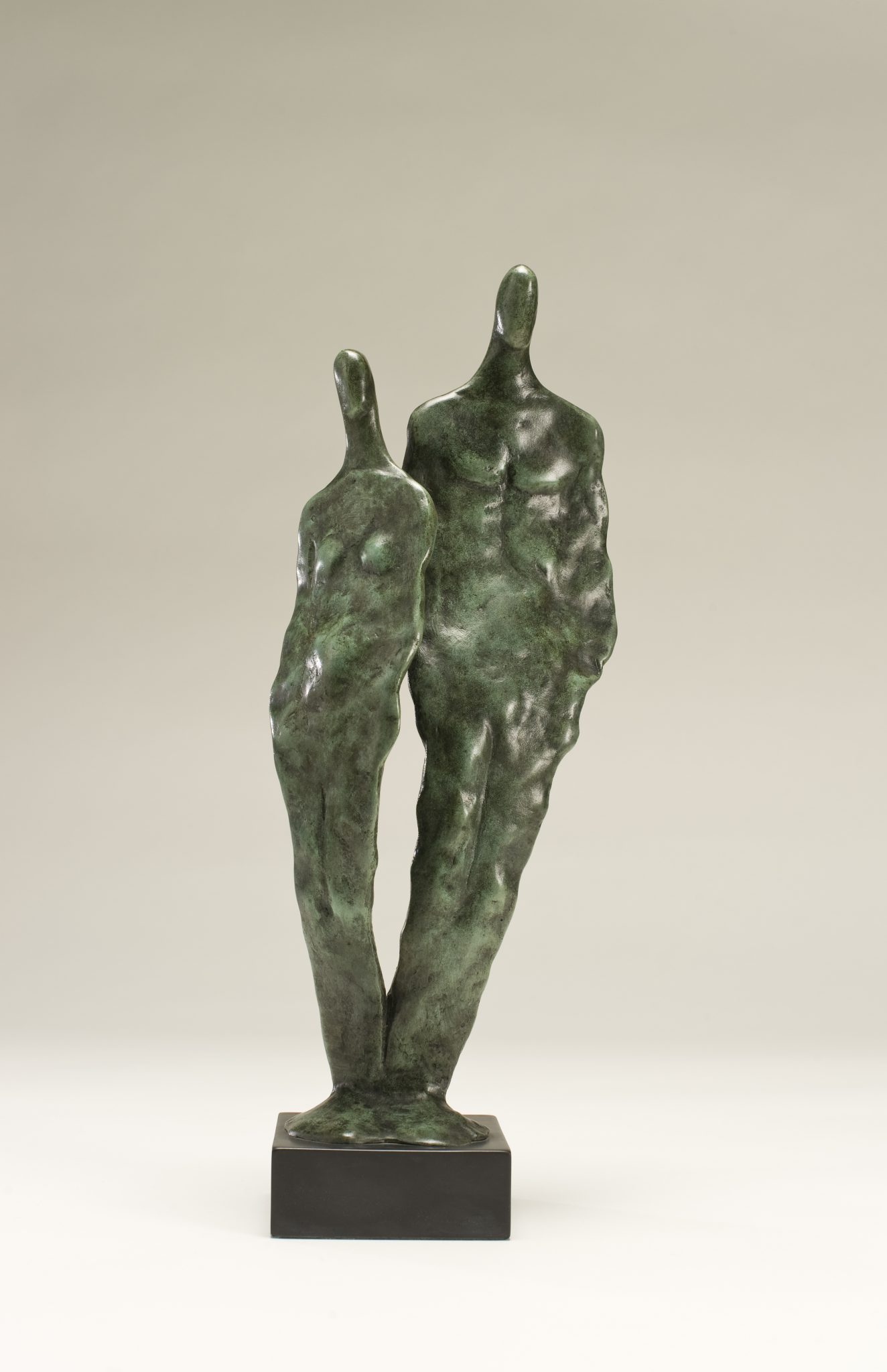 Man and woman sculpture together as one