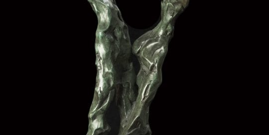 Bronze sculpture of couple.